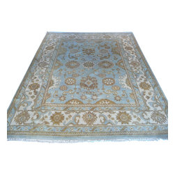 8 X 10 Hand Knotted Light Blue Oushak Rug - Oushak stands for the western Anatolian Turkish city, known for its rare collectible rugs made during the Ottoman Empire. Today we are recreating these historical carpets, in the centuries-old hand weaving techniques, the same fantastic designs in a variety of colors to fit today's decor and taste using natural dyes and hand spun wool.