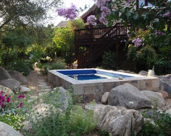 Endless Pools - Original Endless Pools® - This Endless Pool has been stunningly integrated into this natural setting. Its variegated tile seems to have been chiseled from the boulders around it. The installation adds form and functionality to a small outdoor space. Breathe deeply and relax!