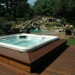 Custom Spa Installations - This hot tub was an added feature to an existing backyard retreat. The key is to ensure it is installed correctly, safely, and in a way that enhances the overall aesthetic design of the backyard.