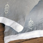 His/Her  Pillowcases, King - A tongue-in-cheek newlywed favorite gets an upscale re-envisioning in these elegantly-embroidered standard-sized His and Hers Pillow Cases.  Made from pure linen in a sophisticated deep dove grey, the pillow cases have neat contrast cuffs with stitched hems in a white cloth that matches the understated embroidery motifs - which are simply the words his and hers stitched in curving capitals at the center of tasteful wreaths.