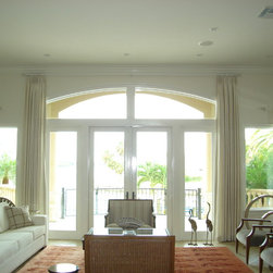 Coastal Contemporary - Beautiful windows with a stunning view are framed with elegant raw silk side panels