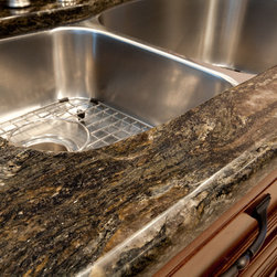 Granite Edge: Half- Bullnose Edge - The Half Bullnose Edge adds curves and highlights the thickness of the granite. It is one of the most subtle edges available.  All our edging is done by hand to get the highest quality of polish and line.