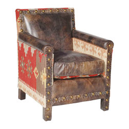 Kathy Kuo Home - Aram Rustic Lodge Kilim Brown Distressed Leather Arm Chair - Make yourself comfortable in this cozy, leather and kilim rustic lodge armchair. The rugged, distressed brown leather upholstery welcomes you home and invites relaxation by the fireside, in the library or sitting room. Woven kilim in gorgeous earth tones adds a natural, eclectic element to a classic chair that's soon to be an old favorite.