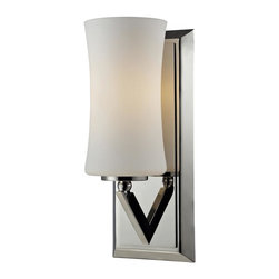One Light Chrome Matte Opal Glass Bathroom Sconce - This one light wall sconce uses an exquisitely designed, angled chrome arm to hold a uniquely shaped, warm glowing matte opal shade.