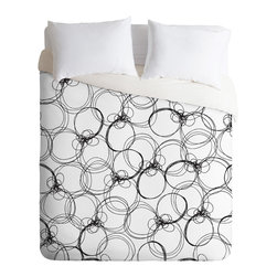 DENY Designs - Rachael Taylor Circles White and Black Duvet Cover - Turn your basic, boring down comforter into the super stylish focal point of your bedroom. Our Luxe Duvet is made from a heavy-weight luxurious woven polyester with a 50% cotton/50% polyester cream bottom. It also includes a hidden zipper with interior corner ties to secure your comforter. it's comfy, fade-resistant, and custom printed for each and every customer.