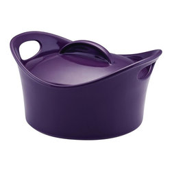 Rachael Ray - Rachael Ray Casserround Stoneware 2.75 qt. Covered Round Casserole - Purple - 53 - Shop for Casseroles from Hayneedle.com! Rachael Ray likes to have fun in the kitchen. You can see that when she cooks up a new dish on her popular TV show. You can also see the fun in the Rachael Ray Casserround Stoneware 2.75 qt. Covered Round Casserole - Purple. Its shape is fun and playful and because it is constructed of fully vitrified stoneware you know its made to last. It has a non-stick surface that makes cleanup effortless and is safe for the dishwasher microwave freezer and oven. About Rachael RayRachael Ray has built a name for herself with a popular talk show a new magazine and a cookbook that reached #1 on the New York Times best seller list. She says that cooking is a way of life and her philosophy shows in her collection of practical yet fun and unique cookware. Each piece in the collection is stamped with Rachael's signature style and the beautiful shapes and vibrant colors will make this cookware a great addition to any kitchen.