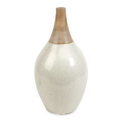 Portia Small Ceramic & Wood Vase - 18H in. - A soft pearl glaze combines with natural wood grain on the Portia Small Ceramic & Wood Vase - 18H in. - and to elegant effect. Made of ceramic with a eucalyptus wood neck.About IMAXWhat began as a small company importing copper flower containers in 1984 by Al and Faye Bulak has developed into one of the top U.S. import companies serving the At Home market today. IMAX now provides home and garden accessories imported from twelve countries around the world, housed in a 500,000 square foot distribution center. Additional sourcing, product development and showroom facilities in the USA, India and China make IMAX a true global source. They're dedicated to providing products designed to meet your needs. This is achieved through a design and product development team that pushes creativity, taste and fashion trends - layering styles, periods, textures, and regions of the world - to create a visually delightful and meaningful environment. At IMAX, they believe style, integrity, and great design can make living easier.