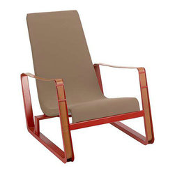Prouvé Cité Armchair - Favored among collectors, the Cité Armchair (1930) exhibits a certain static dynamism inherent to Jean Prouvé's work with its low build and angled backrest. A resilient fabric sling seat is stretched over the chair's tubular steel frame to produce a hammock effect, following the contours and movement of the body for constant support. Distinctive sheet steel runners serve as the base, giving way to thick leather belt armrests that invite contact with their smooth tactility. The tobacco fabric has a red frame; the black fabric has a matching black frame. One of Prouvé's few designs that he used in his own home, the Cité Armchair is a compelling lounge option for residential and commercial spaces. Reproduced to exacting standards by Vitra.