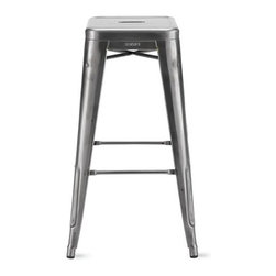 """Tolix - Tolix Marais Barstool - Metalworker Xavier Pauchard not only brought the art of galvanizing steel to France, but took the process to the next level by creating the Marais A Chair (1934), the quintessential café chair that was both elegant and robust enough to grace the decks of the S.S. Normandie ocean liner. """"Xavier Pauchard's Chaise A is a perfect synthesis created by a man possessed of an understanding of raw materials – and the tools used to work them,"""" said Serge Lemoine, former director of Musée d'Orsay, Paris. The Collection expanded to stools as well, and all Tolix metal furniture is still made in Autun, the same Burgundy town where it all began. Slight surface abrasions and markings are characteristic of the material and part of its hardworking machine aesthetic. Rubber feet prevent damage to floors. The Marais Collection will stand up to the rigors of public use, but should be protected from wet weather conditions to maintain the finish. Stackable up to 8 high. Made in France.  Colors are DWR Exclusive."""