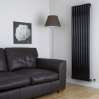 Hudson Reed - Savy High Gloss Black Tall Vertical Designer Radiator 63 x 18 & Valves - Eight circular vertical tubes, finished in superior high gloss black (RAL9005), make this radiator a striking design feature of any contemporary living space. The large diameter tubes deliver an amazing heat output of 1569 Watts (5349 BTUs).Stylish and effective, this modern classic connects directly into your domestic central heating system by means of the radiator valves included . High Gloss Black Vertical Tube Designer Radiator 63 x 18½ Features  Dimensions (H x W x D): 63 x 18½ x 3¼ (1600mm x 472mm x 80mm) Output: 1569 Watts (5349 BTUs) Maximum Projection from Wall: 5.25 (133mm) Pipe centres with valves: 22⅞ (580mm) Number of columns: 8 Circular columns Fixing Pack Included (see image above) Designed to be plumbed into your central heating system Suitable for bathroom, cloakroom, kitchen etc. Weight: 43.65 lbs (19.8kg) Please note: angled radiator valves included  Please Note: Our radiators are designed for forced circulation closed loop systems only. They are not compatible with open loop, gravity hot water or steam systems.