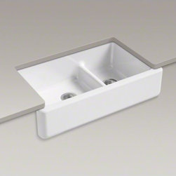 """KOHLER - KOHLER Whitehaven(R)Self-Trimming(R) Smart Divide(R) 35-11/16"""" x 21-9/16"""" x 9-5/ - The Whitehaven apron-front kitchen sink features a streamlined and versatile farmhouse style to complement any decor. The Self-Trimming(R) design requires only a simple rough cut, overlapping the cabinet face for beautiful results. The sink is designed to fit in most standard 36-inch apron-front cabinetry. A low barrier divides the two compartments, making it easy to wash and rinse large items while still keeping the two basins separate. Crafted from enameled cast iron, this sink resists chipping, cracking, or burning for years of beauty and reliable performance."""
