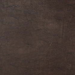 Brown Shiny Upholstery Faux Leather By The Yard - This faux leather material is great for all indoor upholstery applications including residential and commercial. This pattern is uniquely made to combine luxury with durability. Our faux leathers are stain resistant, and easy to clean with mild soap and water.