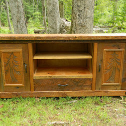 Lakota Cove Barnwood Furniture - This entertainment cabinet has the leaning trees hand carved in the doors.  Adjustable shelves available for entertainment equipment.  Hand forged iron for the handles are the perfect accent.