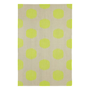 """NY Dot rug in Day Glow - """"We found this amazing pattern in the NY subway, rectangles stacked together to form a circle. Because of the way a dhurrie is woven in a linear fashion this made sense to us as a way to create curve through line. New York, forever inspiring."""""""