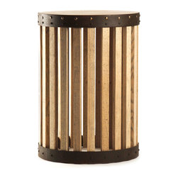 Barrel End Table - Oak and iron combine in an accent surface where rhythm gives a dynamic appeal to traditional materials.  This cylindrical, transitional piece, the Barrel End Table, is bound at top and bottom by bands of nail head-studded iron, distinctive marks of the cooper's craft, while the vertical slats of the walls admit light to keep your room a little more airy.  The piece adds gorgeous structure to your design.