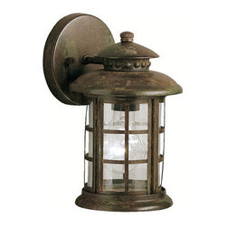 Kichler 1-Light Outdoor Fixture - Rustic Exterior - One Light Outdoor Fixture. If you are looking for a new interpretation of traditional design elements, the Rustic collection is for you. This outdoor lighting line captures the look and feel of a classic, aged lantern, yet updates it for modern homes. Our rustic finish offers you the high quality construction and materials with an affordable price Kichler is synonymous for. Clear beveled glass panels complete the Rustic collection's unique lantern look making it a fantastic value for almost any home. This one light, rustic wall lantern uses a 100-watt bulb and measures 10 high. It is UL listed for wet locations.