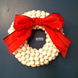 Painted Acorn Holiday Wreath by Buy This, Not That - Acorns go from fall to winter and become a beautiful holiday accessory when painted a milky white in this cute wreath.
