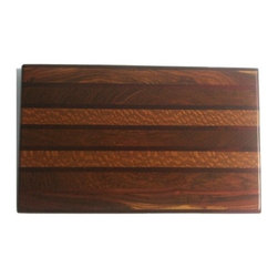 "Exotic Chopping Blocks - 8"" x 12"" Cutting Board - This stunning, sophisticated board is one that will look impressive any way that it is used. The spotted wood in this board is called Australian Lace Wood. Other woods included are Pau Rosa and Ebony from Africa. All the woods are their natural colors. There has been no paint or stain added."