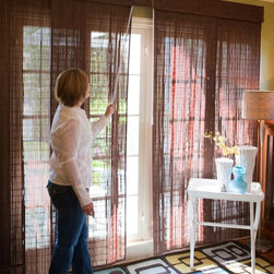 Woven Wood Sliding Panels - Woven wood sliding panels give your home exotic texture and cover sliding doors or french doors with ease. Keep your family safe by choosing cordless blinds like these.