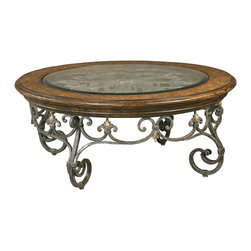 Ambella Home - Montego Round Cocktail Table - If your look is rich and traditional, this cocktail table makes for a lovely addition. The iron scroll work and beveled glass insert are a nod to old-fashioned European craftsmanship. Invite your friends immediately for wine and cheese! This special piece of furniture is ready to serve.