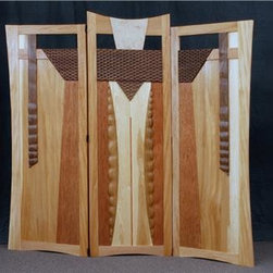 Robe Room Divider - This stunning room divider/screen is made from Quartersawn Sycamore, Cherry, Walnut, Hickory, Butternut, and Bird's Eye Maple and was designed to showcase carved textures with a cohesive design. This is a very unique piece that will enhance the look of any room. The viewer may see a personal image in the carvings; however, the artist saw a ceremonial robe when designed this piece. Tung Oil varnish completes the finish and adds a beautiful luster to an already spectacular art piece.