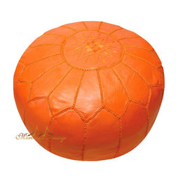 Orange Leather Pouf - A bright orange leather pouf is for extra seating in a cozy corner.