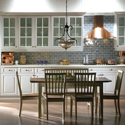 Kitchens - This beautiful clean white traditional style shows of its elegance with raised panel doors on the base cabinets mixed with upper cabinets showing off the beauty of glass mullion doors.