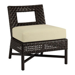 Antalya Outdoor Slipper Lounge Chair: AN-12 - With its clean yet simple form, the Antalya Outdoor Slipper Lounge Chair makes a statement in comfort and function. The rectangular cut-out on the back mirrors the open weave pattern of woven resin that envelopes the frame. A generous seat and luxurious loose cushion complete the design. Available in Driftwood or Havana finish.