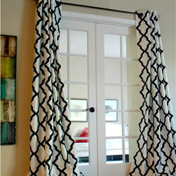 None - Trellis Bold Flocked Curtain Panel - Graphic yet subtle, this Trellis panels offer a touch of a modern statement to your windows. Repetitive black flock patterns on a crisp white textured faux silk style this beautiful piece.
