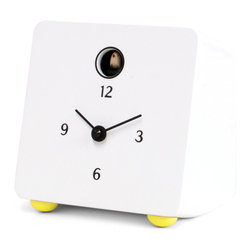 Progetti - Fido 2280 White Clock - Table cuckoo clock that is inspired by the shapes of a famous TV from the 60's, incorporating clean, soft and rounded lines. An object that is 'already at home', already present in the memories of many or in the imagination of those who are fascinated by the years which saw the first steps on the moon, myths that were born and still exist today, such as The Beatles and The Rolling Stones, as well as many events that have left a mark. Fido is made of black-painted wood. It is a compact object that can be placed on a shelf, furniture or on your desk as a trusted companion during hours spent at work. Battery quartz movement.