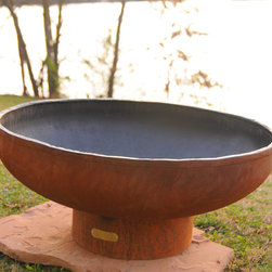 """Fire Pits - Great for Fall and Winter - The Low Boy Outdoor Fire Pit is a high quality, hand cut and crafted fire pit designed for years of heavy use. This is one of the most unique fire pits on the market. Every Fire Pit is individually signed and numbered by it's designer, Rick Wittrig. Each Fire Pit is made from one quarter inch (6.35 mm) thick carbon steel. This is by far the heaviest gauge metal used in any fire pit available today. The sturdy construction assures you of having this functional art for many years to come. They have an iron oxide finish/patina on the outside which will darken a little with time then become permanent. The interior is coated with a high temperature resistant paint and has an 1-1/2"""" rain drain in the bottom. This high quality fire pit requires no maintenance and has an overall height of 16"""" and a diameter of 36"""". Measurements may vary since each fire pit is hand made."""