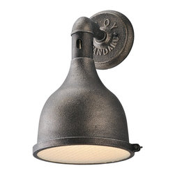 "Troy - Contemporary Telegraph Hill 15 1/4"" Wide Aged Pewter Wall Sconce - This classic large aged pewter wall sconce has the look of an exterior fixture but is designed for indoor use. The hand-spun steel and cast aluminum lamp head holds a single light behind frosted safety glass with an arm attached to an authentic vintage-look round wallplate. A beautiful addition to your home decor from Troy Lighting. Industrial style indoor wall sconce. Aged pewter finish. Hand-spun steel and cast aluminum construction. Frosted safety glass. Round embossed wallplate. Takes one maximum 100 watt or equivalent bulb (not included). 9"" wide. 15 1/4"" high. Extends 9 1/4"".  Industrial style indoor wall sconce.  Aged pewter finish.  Hand-spun steel and cast aluminum construction.  Frosted safety glass.  Round embossed wallplate.  Takes one maximum 100 watt or equivalent bulb (not included).  9"" wide.  15 1/4"" high.  Extends 9 1/4""."