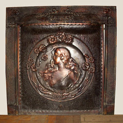 """Art Nouveau Summer Fireplace Cover, Surround - Cast iron fireplace surround and steel summer cover with Art Nouveau female portrait medallion with flowing hair and circled by trailing daisies. All retaining a beautiful original burnished copper wash finish. 30 1/2""""W x 30 1/4""""H (overall); 24""""W x 25""""H (firebox). ca.1910"""