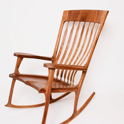 Walnut Rocking Chair - This is the most comfortable chair you will ever sit in. The end. You could learn about complex curvilinear joinery, or the proper way to employ Pi to calculate the rocker radius and leg lengths. Or, just sit in the most comfortable chair you ever sat in, and hold on to this heirloom piece for several generations to come.