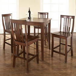 Crosley - Crosley 5-Piece Pub High Dining Set with Cabriole Leg and School House Stools - - Shop for Bar and Pub Tables with Stools from Hayneedle.com! The 5-Piece Pub High Dining Set with Cabriole Leg and School House Stools is an exquisite mix of traditional styling and clean lines. The table and stools are built from hand rubbed hardwoods and the table is accented with a lovely wood veneer. The table's legs are styled in a curving cabriole design while the high stools feature a comfortable back. This smaller size set will fit in a smaller apartment a breakfast nook or take center stage in your family room. The chairs will be transported around your home to provide additional seating for guests. Set includes table and 4 stools. About Crosley FurnitureIn 1920 Powel Crosley founded the company that pioneered radio broadcasting and mass market manufacturing around the world starting with a simple radio meticulously crafted with obsessive detail and accuracy and a measure of consideration for the wallet. These high ideals have served the company well for over 90 years and they live on in the newest addition to the family. Crosley Furniture sets a new standard for innovation function and meticulous craftsmanship in the manufacture of value-priced furniture. They proudly offer durable furniture products featuring hardwood and veneer construction with rich multi-step finishes in a multitude of styles.