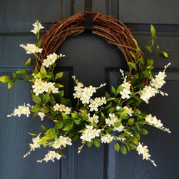 Wildflower Wreath - This wreath is made with a collection of artificial white flower blooms and green foliage.