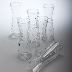 Six Mini Carafes - These miniaturized decanters ensure the perfect pour for each guest at the table.