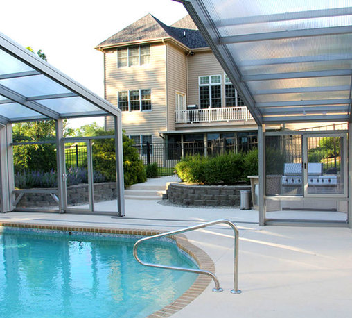 Valparaiso, IN Custom Retractable Residential Swimming Pool Enclosure - A beautiful residential swimming pool enclosure we custom designed and installed for a customer in Valparaiso, IN. The home's outdoor living space was transformed from a summer-only area to a year-round entertainment space.