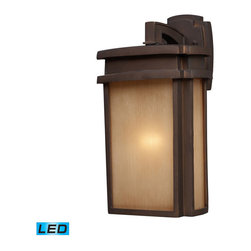 ELK - ELK 42141/1-LED Outdoor Sconce - Simplicity Of Craft And Form Gives The Sedona Collection A Very Attractive Look Through Its Minimalist Approach.  Inspired By The Architecture And Casual Lifestyle Of The Desert Southwest, This Collection Features Clean Lines With Recessed Edges, Caramel Beige Glass, And A Clay Bronze Finish. - LED Offering Up To 800 Lumens (60 Watt Equivalent) With Full Range Dimming. Includes An Easily Replaceable LED Bulb (120V).
