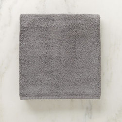 Grandin Road - Micro Cotton Bath Sheet - Soft, super absorbent and quick-drying MicroCotton towels and matching towel-style bath mat. Made from 100% long staple, very fine cotton. Rated the best cotton towel in America by Real Simple magazine. Fiber length and density allow towels and mats to absorb moisture 250% faster than a regular cotton towel. 600 GSM weight. Extra absorbent and rated the best cotton towel in America by Real Simple magazine, MicroCotton towels make a great addition to the master or guest bath. Each size is sold individually and made from exceptionally soft, silk-like, 100% long-staple cotton fibers that weigh in at 600 grams per square meter. Each cotton fiber is very fine and longer than those used in some of the finest Egyptian cottons: each loop is made up of 120 fibers, whereas regular cotton towel loops are made of 30 to 40 yarns. Each size is available in a wonderful array of hues; the color selection coordinates perfectly with the Reversible Cotton Bath Rug.. . . . . Machine washable: wash dark colors separately in cool water (40 degreesF), do not use bleach or products containing benzoyl peroxide. Towel-style bath mat does not have a rubber backing. Each piece sold separately. Imported.