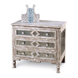 "Diamond Antique Mirror Bedside Chest B - 30""H x 34""W - Geometric but reflecting the sensibilities of the old world, the three-drawer Diamond Bedside Chest is inlaid with hand-antiqued mirror panels that add lightness and a certain dignified flash to its traditional shape.  Each drawer has a separate rectangle of mirror adorned with an open diamond of the same pale antiqued wood that makes up the chest's sturdy frame and refined turned feet.  Double drawer pulls and an ornamental squared apron complete the transitional look."