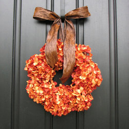 Pumpkin Wreath Fall Hydrangeas by Two Inspire You - This is the season of beautiful wreathes. Give your house some personality with one.