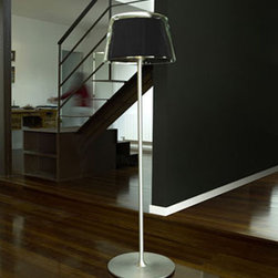 Gretta 50 Floor Lamp By Modiss Lighting - Gretta 50 from Modiss is a modern floor lamp part of a series of lamps that feature a glass diffuser around the fabric shade.