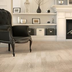 Lauzon Authentik - This red oak flooring has a subtle texture that is timeless and historic with a modern twist of subtle, rustic texture. The floor is featured here in the color Absolut.