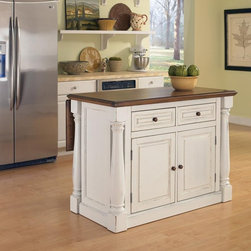 Home Styles - Home Styles Monarch Kitchen Island Multicolor - 5020-94 - Shop for Kitchen Islands from Hayneedle.com! The stylish antique design of the Home Styles Monarch Kitchen Island is both warm and welcoming and the level of convenience it provides isn't too bad either. Offering both quality and comfort the Monarch was crafted from hardwood solids and engineered wood with a distressed oak finished top and matching oak finished knobs for a highly decorative appearance that's also quite sturdy. This island features two storage drawers and a large cabinet with four adjustable shelves that can be customized to fit your needs. Most interestingly though is the extendable breakfast bar that stretches the top surface from 25 to 40.5 inches so you can relax to a full breakfast buffet right on your island! Measures 48W x 25D x 36H inches.About Home StylesHome Styles is a manufacturer and distributor of RTA (ready to assemble) furniture perfectly suited to today's lifestyles. Blending attractive design with modern functionality their furniture collections span many styles from timeless traditional to cutting-edge contemporary. The great difference between Home Styles and many other RTA furniture manufacturers is that Home Styles pieces feature hardwood construction and quality hardware that stand up to years of use. When shopping for convenient durable items for the home look to Home Styles. You'll appreciate the value.