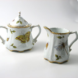 "Greenleaf Sugar & Creamer Set - Internationally known designer Anna Weatherley's exquisite porcelain is handpainted in Budapest, Hungary. Trained in the classical painting tradition, the artisans in Anna's studio are only the best painters capable of mixing the colors and painting the delicate details of her designs. Each piece is a functional work of art. Each painter has a distinct technique and secret way of mixing colors to create the ""painting-like"" effect. While Anna Weatherley's designs are rooted in history, they are equally at home in contemporary or traditional settings."