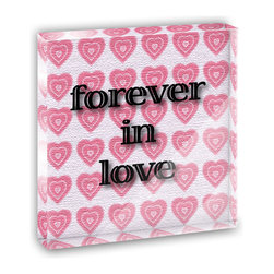"""Made on Terra - Forever in Love on Pink Hearts Pattern Mini Desk Plaque and Paperweight - You glance over at your miniature acrylic plaque and your spirits are instantly lifted. It's just too cute! From it's petite size to the unique design, it's the perfect punctuation for your shelf or desk, depending on where you want to place it at that moment. At this moment, it's standing up on its own, but you know it also looks great flat on a desk as a paper weight. Choose from Made on Terra's many wonderful acrylic decorations. Measures approximately 4"""" width x 4"""" in length x 1/2"""" in depth. Made of acrylic. Artwork is printed on the back for a cool effect. Self-standing."""