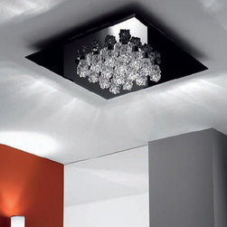 """Axo - Axo Subzero ceiling light 16 - The Subzero ceiling light has been designed by Manuel Vivian for AXO light. The Subzero series features a collection of lamps made of Bohemian crystals along with a chrome finish. This dazzling ceiling light conceives an enigmatic look by means of its slick design.  Product Details:  The Subzero ceiling light has been designed by Manuel Vivian for AXO light. The Subzero series features a collection of lamps made of Bohemian crystals along with a chrome finish. This dazzling ceiling light conceives an enigmatic look by means of its slick design. Details:                         Manufacturer:             AXO Light                            Designer:                        Manuel Vivian                                         Made in:            Italy                            Dimensions:                         Height: 5"""" (12 cm) X Width: 25"""" (65 cm)                                          Light bulb:                         16 X 20W G4                                          Material:             metal, Bohemia crystals,"""