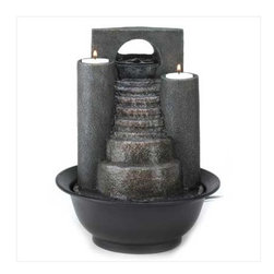"n/a - Eternal-Steps Water Fountain - Fire and water combine to form one spectacular decoration.  Cascades of water trickle down faux-stone steps, while tealights glimmer from atop twin pillars.  A tabletop fountain to  treasure.  Polyresin.  UL recognized.  Candles not included.  8.58"" diameter x 11"" high."