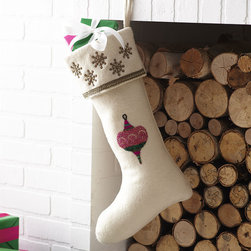 A MERRY LITTLE STOCKING – TOP - NEW - Hang from the chimney with care—these stockings are ready to be filled with cheer! Spruce up your holiday home with this classic design. Hand-beaded and wool blend lined with satin, this chimney charmer is trimmed with a snowflake pattern along the top rim with a part of the holly jolly spirit in the center—bring good tidings to your décor (and you!).